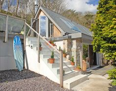 Love the interior, and use of large sliding window doors. The Boat House   Small House Swoon