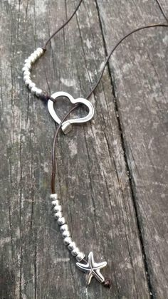 uno de 50 style ______________________________________ silver heart necklace is made of natural leather made in Spain with quality material, is hand-made with style one of 50. get in touch if you want more information. long leather necklace made with leather and zamak , the