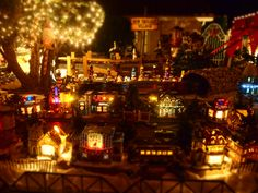 Christmas spirit at Jackie's house. Huntington Beach, CA. The most beautiful display I have ever seen - hundreds of these miniature music box houses displayed as a magical Christmas town with a train going around the outside. There is ice skating and people shopping, too. She has a gorgeous Nativity in the driveway, and a music box circus. It's a lot of work, so I wanted to share these so others could appreciate what she does every year. Thanks Jackie!