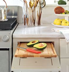 A cutting board installed in a pullout drawer just above the pull-out garbage makes for easy disposal and takes up less counterspace.