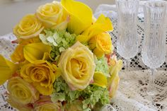 Yellow, yellow and orange roses, yellow callas and green hydrangea bouquet. Created by CS Events and Floral. Las Vegas, NV.