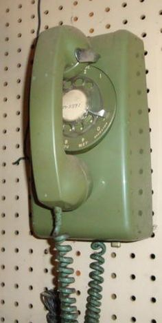 Green Rotary Dial wall phone!! Sometimes I find myself twirling an imaginary cord while talking on my iPhone...