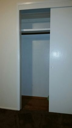 Closet doors painted white and inside closet