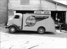 A Coca-Cola Advertising Truck. Trucks like this delivered and installed the coveted Coke signs that sell for so much now on eBay.