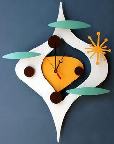 Retro space age clock. LOVE THIS SHAPE DESIGN!!