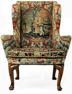 A GEORGE I WALNUT WING ARMCHAIR CIRCA 1720 Upholstered in associated 18th century close-nailed gros and petit-point floral needlework, the back and seat depicting classical figures, on cabriole legs with pad feet
