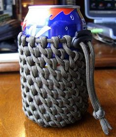 Half hitched paracord can koozie. About 1.5 feet of paracord for the drawstring/cinch cord with cordlock, and 30 feet of paracord for the half hitching around the can.