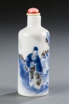 Lot 499: A Chinese porcelain snuff bottle with scholar and attendant under tree in blue under glaze. c.1800-1880. Estimate: $300-$500.