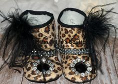 "Adorable leopard soft soled boots lined in faux fur and adorned with Ostrich feathers, rhinestone trim and a black stone and rhinestone piece on the toe of each boot. Too cute for words!  SIZE APPROXIMATELY 9-12 months  Measures 5"" from heel to toe Click on photo to view detail"