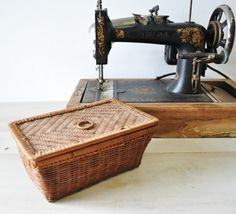 antique wicker sewing basket....not to mention the antique machine!!!