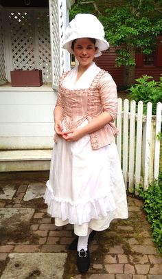 "Two Nerdy History Girls: Keeping Cool in 18th c. Style in Colonial Williamsburg - ""Abby is wearing a short sack, made of a light-weight, high-end cotton in the style of the 1770s. The sleeves are unlined, and the sack's loose-fitting, pleated back gives it an airy feel. Her petticoat is made from a cotton that's woven in a mock quilted pattern, and her apron is sheer cotton muslin. Beneath it she's wearing her usual linen shift, linen-lined stays, and cotton stockings."""