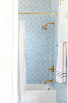 38 Beautiful Fish Scale Tile Bathroom Ideas https://www.futuristarchitecture.com/13412-fish-scale-tile-bathroom.html