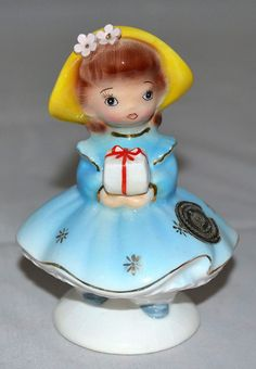 Cute vintage norcrest, coronet, py brown haired girl carrying gift figurine