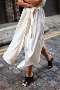 For a causal day out pair a midi drawstring dress with some mules.