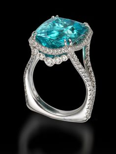 12 carat Paraiba tourmaline from Mozambique, Africa. Set in a beautiful platinum setting with diamond accents. #Paraiba #ParaibaTourmaline