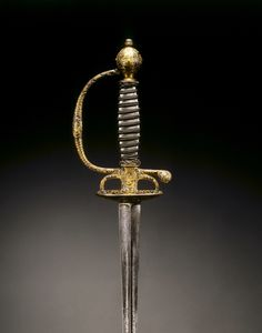 Smallsword, c. 1730 France, Paris, 18th century steel, blued, with gold encrusted decoration; chased and engraved; silver wire, Overall: l. 94.50 cm (37 3/16 inches); Blade: l. 77.20 cm (30 3/8 inches); Grip: l. 13.20 cm (5 3/16 inches); Guard: w. 8.00 cm (3 1/8 inches).