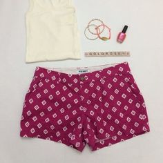 """Old Navy pink/white diamond print shorts Bright pink shorts with white diamond print, size 8, 16.5"""" waist across laying flat, 3"""" inseam, 9"""" rise, 100% cotton, machine wash cold. Non-elastic waist with front button and zipper, 2 side pockets, 2 back pockets. Worn once so it's in excellent condition. No damage/fraying/stains. Has been cleaned and stored in a non-smoking/pet-free home. Shirt, nail polish, bracelets not included. No trades or PP. *15% off bundles of 2+ items!* Old Navy Shorts"""