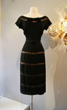 The perfect little black dress, 1950's black rayon with illusion lace.