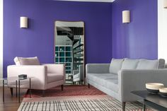 Sarah Lavoine   Interior designer. Contemporary pink chair and gray sofa, blended with a purple painted wall.