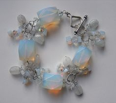 Opalite and moonstone bracelet on white by j3jewelry, via Flickr; Opalite, moonstone, crystal and rock crystal. All headpins, links and toggle clasp are sterling silver.
