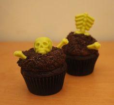Spooky Graveyard Cupcakes!!  Dark chocolate cupcakes, chocolate buttercream, Oreo crumbs, and spooky bright green chocolate bones!