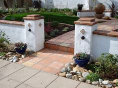 Spanish Style Maybe take tile from steps and add decorative tile to entrance walls
