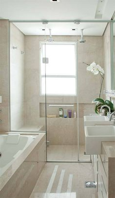 LOVE the SOFT colors. Modern! Walk in Shower with niche below window, soft, calming color scheme.
