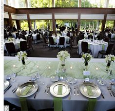 To achieve a simple spring look and take advantage of the glass-enclosed venue, the reception was decorated with white and apple green linens. from the album: Sara & Paul: A Spring Wedding in Indianapolis, IN