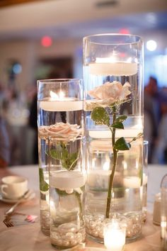 Simple Do-It-Yourself Cheap Wedding Centerpieces Ideas - Romantic DIY Floating Candles Crafts Ideas Candle Wedding Centerpieces, Diy Wedding Decorations, Centerpiece Flowers, Floating Candles Wedding, Cheap Table Centerpieces, Floating Flower Centerpieces, Cheap Table Decorations, Modern Centerpieces, Candle Decorations