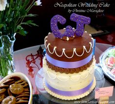 I think this is such a cute cake. Love the chocolate and purple :)