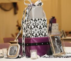 Center Pieces Purple, & Black Stacked Packages