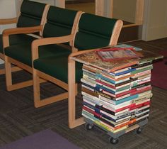 Magazine table I made for the high school library. It is made out of withdrawn books which have been stacked and glued.