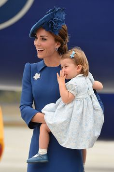 The Duchess of Cambridge carries Princess Charlotte as they arrive at Victoria International Airport. (Photo by Dominic Lipinski/PA Wire) via @AOL_Lifestyle Read more: http://www.aol.com/article/lifestyle/2016/09/26/kate-middleton-red-preen-canada/21479823/?a_dgi=aolshare_pinterest#fullscreen