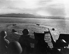 LCVP landing craft circling off Cape Torokina, Bougainville, Solomon Islands while awaiting orders, 1 Nov 1943; note 20mm Oerlikon AA gun; photographed from aboard APA-13 USS American Legion ww2db Photographer   P. Scheer Source   ww2db United States Marine Corps Identification Code   USMC 67319