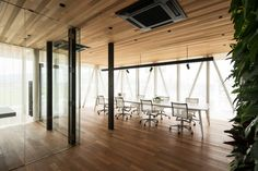 Tree grows through voids in Hamada Design's Glass + Wood building Office Interior Design, Office Interiors, System Furniture, Timber Deck, Glass Facades, Commercial Interiors, Modern House Design, Interior Architecture, Wood