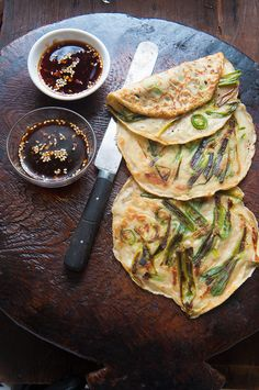 Korean scallion pancakes (Pa Jun) ~ good recipe here: http://koreanfood.about.com/od/vegetarianrecipes/r/Scallionpancake.htm