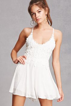 A woven romper featuring a V-neckline, an ornate crochet bodice design, crochet detailed cami straps with a back crisscross adjustable self-tie, and a flowy silhouette.<p>- This is an independent brand and not a Forever 21 branded item.</p>