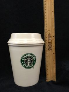 COLLECTORS OF STARBUCKS PARAPHERNALIA WILL APPRECIATE THIS GIANT OVERSIZE CERAMIC COFFEE CANISTER. RUBBER SEALED LID LOCKS IN FRESHNESS. GOOD CONDITION WITH A SHALLOW FLAKE ON THE BASE. 7H X 6W