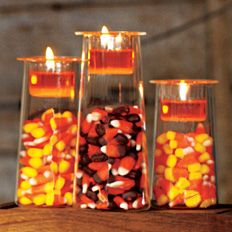 """Halloween Treat"" Symmetry Trio by #PartyLite #Candles decorated with orange votives and candy corn - Click for more decorating ideas"