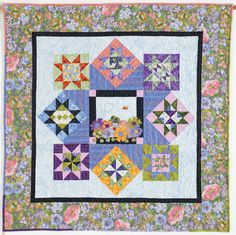 Bee in My Garden by Randy Danto featuring fabrics from Garden Medley by Susie Johnson. Photo courtesy of Quiltmaker's 100 Blocks , Vol 6 Winter 2012