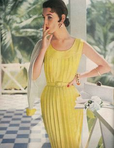 May Vogue 1954    Pleats - a tube of them - stitched from yoke to hem, made here in Mimosa shantung, Vogue pattern S4499