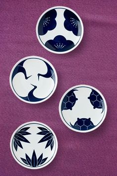 """Traditional symbols made modern and elegant with deep navy blue and a clean design. This is a set of four assorted plates in a black gift box. Each plate is also sold individually. Perfect for treats during tea time or to rest the tea bag. Great for trinkets, jewelry, soap, votive candles or just display. Dishwasher/microwave safe. 4.75"""" diam. www.miyacompany.com"""