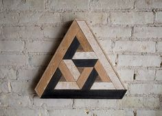 17.5in H x 15in W Handmade wood wall art with reclaimed wood pattern. We can customize sizes of this design in our shop if this one isnt just right for your space. This Penrose can be used on a wall needing some love, a shelf or mantel, or add it to a gallery wall. Size, color and texture will have small variations due to the nature of reclaimed wood. Made with raw reclaimed wood. Can be customized. This design is copyright protected. Created by Eleventy One Studio.