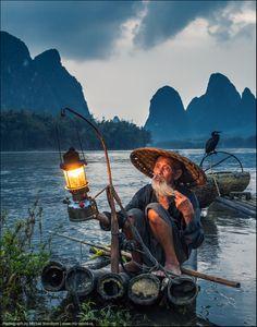 Fisherman and Cormorant, Guangxi, China.