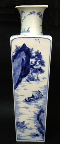 A Fine Early Kangxi Square Porcelain Vase. The Flared Cylindrical Neck Tops a Rectangular Body Which Tapers Towards the Base. The Recessed Base Contains a Ming Chenghua Mark (1465 - 1487). The Vase is Decorated With the Scenes From the Well Known `Ode to the Red Cliff` by Su Shi (1037 -1101) and Two Panels of the Poem with a Seal Mark. As with Other Vases From this Group the Painting is Very Well Executed and Subtle. The Neck is Decorated with Rock-work and Bamboo.