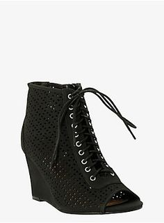 """Have fun cutting loose in this cut-out bootie. This sleek contemporary look has a trendy perforated design with a casual lace-up front. A side zip makes this peep-toe style an easy slide-in-and-go number.<ul><li> 3 1/4"""" wedge</li><li>Man-made materials</li><li>Imported</li></ul>"""