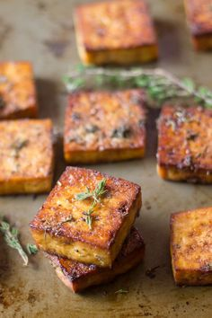 This flavor-packed baked tofu is soaked in a marinade of zesty lemon juice, zippy garlic, and savory herbs, then baked to perfection. It's the perfect filling for a delicious vegan sandwich or part of… Vegan Foods, Vegan Dishes, Tofu Dishes, Vegetarian Recipes, Healthy Recipes, Vegetarian Salad, Grilled Tofu Recipes, Firm Tofu Recipes, Gourmet