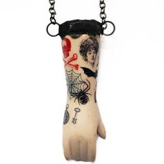 """Tattooed"" doll arm on extra long chain.  Meant to hang low."