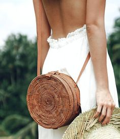 The Petit Oiseau Roamer round bag is one of our best-sellers! Hand woven grass rattan with batik fabric lining. Made in Bali. diameter, 2 deep 18 drop, total length is 26 Shop Petit Oiseau It Bag, Round Bag, Round Basket, Round Straw Bag, Look Plus, Basket Bag, Summer Bags, Summer Fun, Mode Outfits