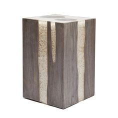 Acrylic resin is combined with teak to make this versatile stool or accent table. The resin is filled with white river stones. A fun piece that is both organic and modern! Two sizes available!!   *Natural variation to be expected in each product.